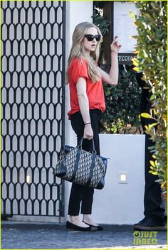 Amanda Seyfried with her vintage Christian Dior bag,  1.2013
