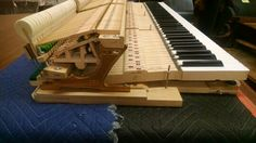 All the moving parts inside a grand piano, called the action.