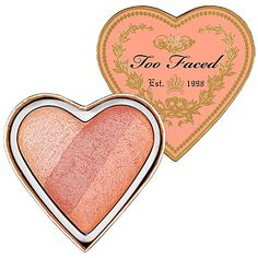 Too Faced | A trio-color blush packed into one pretty heart. WHAT IT DOES:Three perfect swatches of ultraflattering blush allow you to either swirl the colors together and apply or use more of one shade for a custom flush or highlight. This blush was developed with easy application and a no-fail color palette to take the guesswork out of creating a sweet, romantic flush. With a baked color formula— the same technology that allows it to truly work on all skintones—the blush can be applied as…