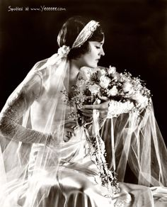 1930's bride. They used to take fresh flowers and tie them to ribbons and extend them down from the main flower.  These ribbons of fresh flowers tied to them were called 'love knots'.  Beautiful.  I bet they come back in style soon.
