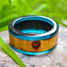 ~This U N I Q U E bangle features native Australia cypress and ocean blue resin…