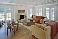 Reclaimed teak flooring successfully blends traditional and modern elements.