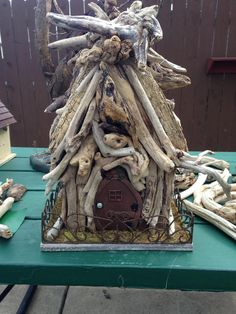 The beginning of my fairy house- not done yet.... Love the driftwood!