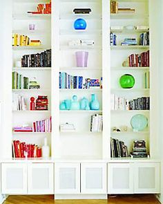 This is such a fun bookshelf. Too bad most people have normal, non color-coordinating books to go on a bookshelf.  but i wouldn't mind having a big, tall shelf like this and adding a few fun decorative things