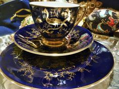 COALPORT TEA CUP AND SAUCER TRIO COBALT BLUE EXOTIC GOLD BIRD AND INSECTS