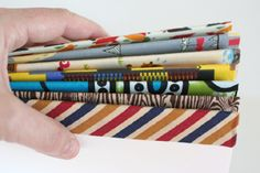 Cute, easy, quick way to dress up some simple notebooks. In this tutorial she sews her pages with a sewing machine, but you could just as easily use these on a simple 3-hole pamphlet stitch.