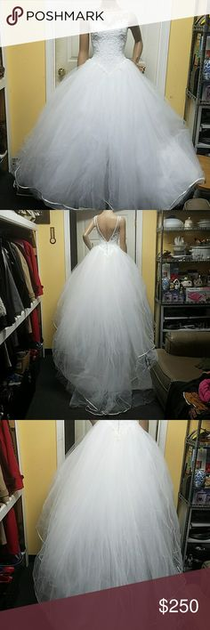 Venus wedding dress. Size 23 waist This is a gorgeous wedding dress. It has cerebral layers of tulle underneath it can be made as big as you want it. It can be used for a bar mitzvah or a wedding dress it is that perfect dress. I am pricing it to move so please no low ballers. It has normal wear and tear nothing to be concerned about you may have to put it in the cleaners. Venus Dresses Wedding