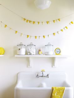"""Extra glass jars from the pantry serve a purpose in the laundry room, where they hold detergent and soap. Not only does Emerson say it helps her know when she's running low on supplies, but she also says removing brand labels and packaging elevates common staples to a raw, beautiful state."""