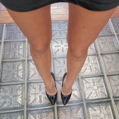 Black patent pumps, toe cleavage, and long legs