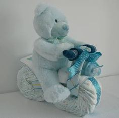 Harley bike nappy cake   32 nappies,  1 blanket,  1 muslin,  Johnson's cotton buds or Baby Bottle,  Vest, ,  booties,  bib,  dummy   teddy.