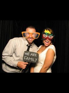 Bride and her cousin photo booth wedding reception. Made our own signs, bought props at dollar store.