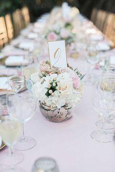 White-and-blush centerpieces in silver vases   Brides.com