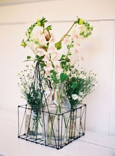 milk bottles cluster filled with flowers...