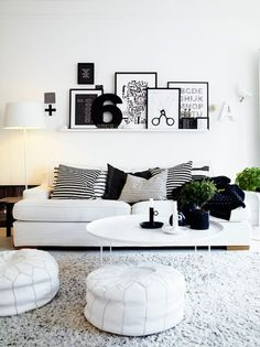 Love the shelf arrangement - above the couch is a cool idea too.