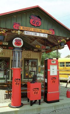 "Route 66 Filling Station. Old fashioned gas pumps and other memorabilia outside the gas station Bill Shea opened more than fifty years ago. It is now a museum in Springfield, Illinois. ""The Fine Art Photography of Frank Romeo."""