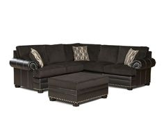I love the uber modern Davis Sectional! A studded, bonded leather-chenille bicast sofa & matching ottoman. To special order visit naderslp.com
