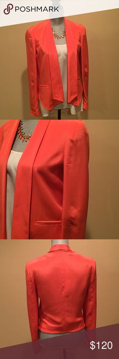 Rebecca Minkoff blazer Stunning orange Rebecca Minkoff blazer. Has beautiful detailing in the sleeves. Has two non-functional pockets. Fully lined. Shell is 100% silk lining 100% silk. I only wore it a couple of times, it's in excellent condition. Rebecca Minkoff Jackets & Coats Blazers