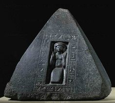 Pyramidion of Pta-mose. Top of the private tomb chapel in Thebes-West. The defunct is praying to the morning and evening sun. Black granite (around 1400 BCE), 18th Dynasty, New Kingdom, Egypt.  Aegyptisches Museum, Berlin, Germany