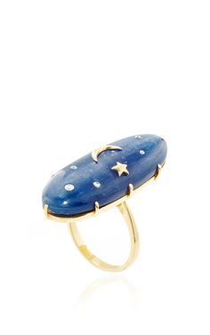 Known for her signature use of color and sophisticated, feminine aesthetic, this ring by **Andrea Fohrman** features an oval shaped kyanite structure embellished with white diamond details and a 14K gold star and moon.