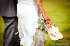 I love the details in this wedding. You had me at the mehndi tattoo. By Come Together Studios
