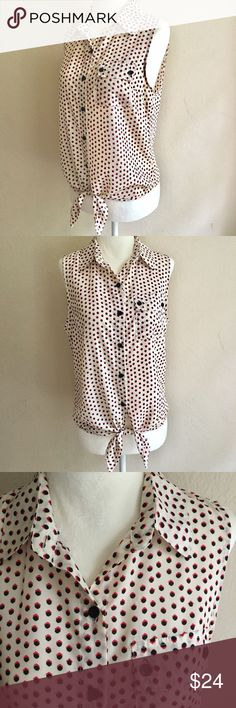 """Timing Retro Style Sleeveless Button Down Timing brand silky soft good quality polyester sleeveless button down collared shirt with front ties. Retro style print is cream with red and black polka dots. In excellent preowned condition. No stains, holes, or significant wear. Size small. Excluding the ties, length is approximately 21"""". Tops Button Down Shirts"""