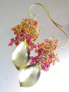 ..........color infused.....elegant jewels Pristine and shapely lemon quartz briolettes (22mm) are topped with tumbling tassels of sapphires (yellow, orange, raspberry), and smooth ruby. Each rondelle sits on a vermeil head pin. Wire wrapped to a short slender chain. Hand fabricated 20 gauge 14k gold filled ear hooks. Length, from head to toe, is just a short shot over 2 (5cm). thank you~ tracey More bellajewels tassels::: https://www.etsy.com/shop/bellajewelsII/s...