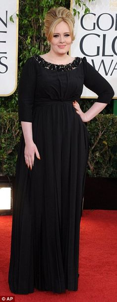 Contrast: While the dress divided opinion, it makes a nice contrast from the black gowns Adele usually wears to red carpet events