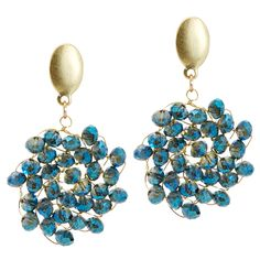 """Love this! Found it on Renee'  Pretty earrings that dress up your everyday wardrobe: the Montana blue crystals in these drop earrings sparkle and grow translucent in sunlight. Threaded on gold wire, the teal crystals form a pinwheel dangling from a brushed gold oval.  - Brushed gold base metal, crystals, gold wire  - 1"""" diameter dangle; 1 1/2"""" length  - Post back closure  Item # WAS20001003"""