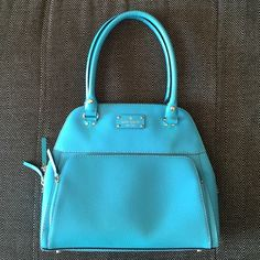 Kate Spade Bag Gorgeous leather turquoise kate spade bowler bag. Zipper pocket and 2 small open pockets on inside. Cute polka dot interior. Great condition! kate spade Bags Shoulder Bags