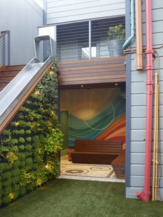 San Francisco garden that combines stone mosaics, a colorful mural, vertical gardens and even a slide