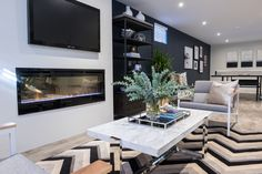 """Check out this gorgeous Prism Installation on """"Property Brothers: Buying & Selling"""" episode 409 - Derek & Melanie Property Brothers, Hearth, Fireplaces, Indoor, Check, Inspiration, Decor, Log Burner, Fireplace Set"""