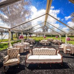Look at this Gorgeous Clear tent provided by @rentalandevents tents! I loved the brides vision and how she made a custom seating area around the dance floor .  The tent allowed the guest to have beautiful panoramic views of the sunset and lake.  I also love the mahogany Chivari chairs they make the room look so elegant.