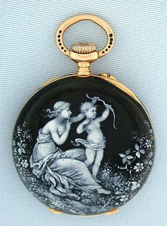 Fine, beautiful and unusual Swiss 18K gold and enamel ladies antique pendant watch by Ed Koehn, Geneva, circa 1890. The case back with white enamel woman and cherub in a garden against a black enamel background, the front bezel with similar decorations.