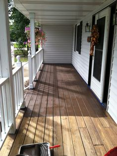 """Behr Porch And Patio Paint Deck Color White Columns Black Rails Like That Matches – Porch Ideas from """"Behr Porch and Patio Paint"""" Pictures Wooden Decks, Deck Paint, Concrete Porch, Porch Design, Painted Patio, Deck Stain Colors, Deck Over, Porch And Patio Paint, House Exterior"""