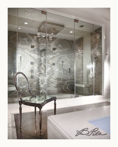 One of my favorite bath projects - shower of marble slabs pieced together to create natural patterns. #interiordesign #style