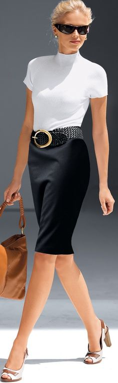 cv/ Black pencil skirt but the edge is that now we are mixing black with brown.  (IE:black skirt but carrying a brown bag and shoes are cream or white and brown.) The shoes and bags are not a perfect match now either. Very clean classic lines though.