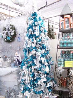 Bright blue and icy white.   Joys of Christmas: Themed Christmas Trees