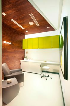 Miami Interior Designers from DKOR Interiors doing a Miami Modern Scandinavian inspired project for a doctor's office located in Aventura, FL  Magnetic glass board Color Accents Wood ceiling wrap DWR Contemporary Office Miami Commercial interior design project www.dkorinteriors.com