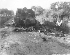 """A Hummel of 12. SS-Panzer-Division """"Hitlerjugend"""" destroyed in the Falaise pocket. The crew lies dead on the floor"""
