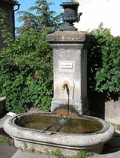 1883 stone fountain in Ansouis.