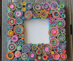 Upcycled Rolled Paper Frame. Note that the blogger said that it took FOREVER to make but it's still cool enough that I don't want to forget about it. Might be something to do on the airplane.
