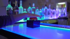 """Interactive activities provide an opportunity for your guests to interact with BottLED®. This results in increased entertainment and consumption at the bar counter.  By pressing the buzzer, undecided guests can get decision guidance when choosing their next drink.  As with classic roulette, the """"Bottle-Roulette"""" selects randomly, creating a relaxed mood and entertaining your guests.  #bar #spirits #cocktails #lighting #led #bottles #bardesign #bottled"""