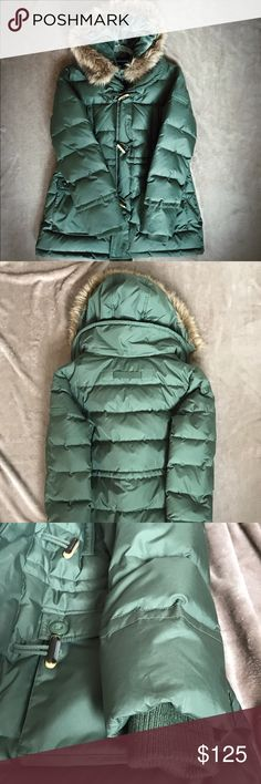 """Tommy Hilfiger Down Puffer Coat ✨ SO WARM ✨NWT✨Truly the warmest coat I've ever tried on! Down filled, gorgeous green Puffer Coat. 7 pockets! 2 zip pockets at chest. 4 pockets at hip, one inside. Tab on back to hang it. Toggle closure placket covers the zip up closure. The BEST part is the luxury HOOD! With a faux fur trim, it is plush, cozy and the lining is velvety butter soft! Measures 29"""" long from shoulder to hem and 20"""" across bust. Has the pulls on inside to cinch at the waist. I hope…"""