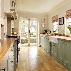 Practical layout Step inside this traditional soft green kitchen Reader kitchen PHOTO GALLERY Beautiful Kitchens Housetohome Kitchen Paint, New Kitchen, Sage Kitchen, Green Country Kitchen, Kitchen Doors, Galley Kitchen Design, Light Green Kitchen, Modern Country Kitchens, Galley Kitchen Remodel