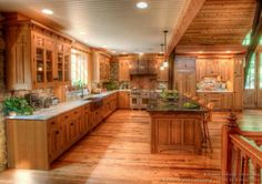 wood cabinets with the white ceiling and counter keeps it from being to dark. ...open to vaulted great room, like the touch of stone on kitchen wall