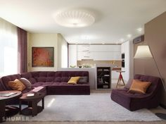 Another white living room, this time one wall is painted in beaver shade of brown for contrast. the interior is ample, having a white round chandelier, Byzantium sofa for one corner and another one, in the same color, emphasized by the beaver wall. The pillows are in shades of brown, the carpet is large and white, some discrete light spots and lot of elegance dominate the room.