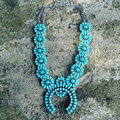 """Our gorgeous faux turquoise squash blossom is a gorgeous reproduction of the popular old pawn Navajo squash blossom necklaces. This necklace measures 17"""""""" in length, plus includes an extension chain."""