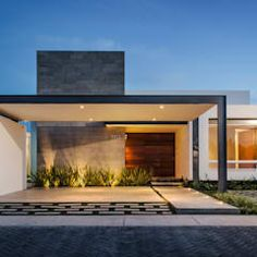 Maisons de style de style Moderne par ADI / arquitectura y diseño interior