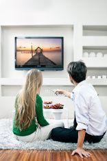 Watching Holiday TV programme stock photo