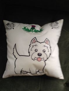 Details at a Glance: Item: Decorative Throw Pillow Theme: Westie with Thistles Size: 14 x 14 Fabric: Cotton Sheeting with Polyester Filling Colors: White with black, pink, green and purple Care: Remove stuffing; machine was and dry; iron ON BACK Craft: Heat Transfer This perky West